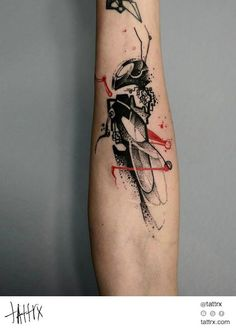 Black And Red Abstract Grasshopper Tattoo On Forearm