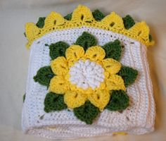 Baby Blanket - Sunflower Squares. This adorable baby blanket uses the crocodile stitch to make the flower petals and leaves stand up from the surface of the blanket. What baby would not love to spend their tummy time grabbing at the flower petals? And just think of all the photos you can take with it!.