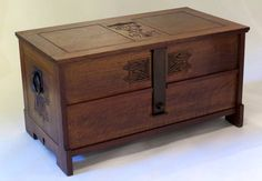 """Charles Rohlfs blanket chest with carved monogram """"MRS"""" with hammered copper hardware. Interior ash lined with two interior storage trays with leather handles over a hidden drawer. Signed with carved monogram and dated 1907. 48""""w x 25.5""""h x 25.5""""d"""