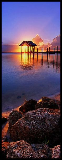 Starburst Sunset Over House Of Refuge Pier In Hutchinson Island At Jensen Beach, Fla Photograph by Justin Kelefas