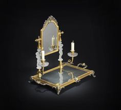 A Baccarat glass, silvered and gilded miroir de toilette, late 19th century.