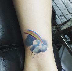 Rainbow tattoo: il tatuaggio con l'arcobaleno che appare sulla pelle -cosmopolitan.it More