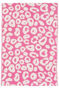 Dash and Albert Spot Fuchsia Woven Cotton Rug. Show your wild side with this vibrant woven cotton area rug. In a funky animal print and fuchsia hue, this rug is perfect for adding a fresh, fun touch to a girl's bedroom, play space, or even the living room!