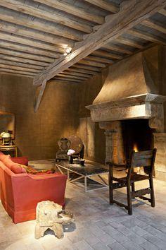 reclaimed beams, floor tile, stone fireplace...beautiful! Van Apers