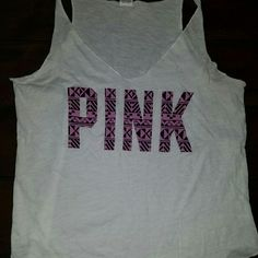 PINK by VICTORIA'S SECRET White tank with pink/black lettering  tag states . sleepwear wore it 1 time as a tank top PINK Victoria's Secret Tops Tank Tops