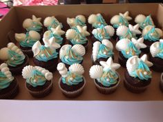 Sea shell cupcakes!  White candy melt shells. Teal frosting, pearl candy and crushed gr cracker sand. Perfect!