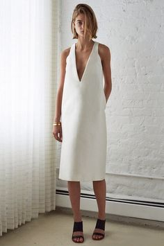 White dress + black sandals + gold cuffs = the perfect minimalist ensemble.