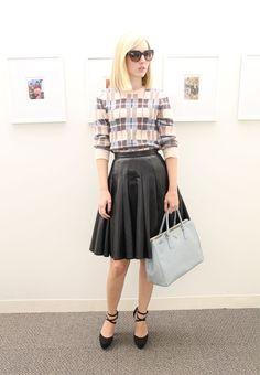 NYFW style: Jane Keltner de Valle wears a Jonathan Saunders sweater, Junya Watanabe skirt, Christian Louboutin heels, Prada bag and sunnies