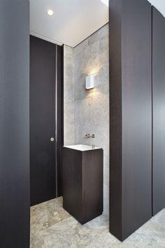 Custom Millwork frames out this sleek powder room // S E K U L S K A