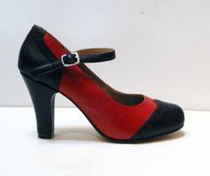 """The Babyjane is a perky round toe high heel pump with sexy arch strap and """"wing tip"""" two tone details. Leather uppers with leather soles Whole and half sizes, 5"""
