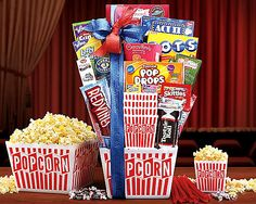 Popcorn and Candy Collection Gift Basket  Dark Chocolate Creme Wafer Cookies  Lollipops Caramel   Red Vines Licorice  Chocolate Chip Cookies  Blue Raspberry Hard Candies  Candy Apple Caramels  Air Heads Candy Green Apple Flavor  Air Heads Candy Cherry Flavor  Chewy Lemonhead & Friends Candy  Nestle's Wonka Nerds  Act II Kettle Corn 3-pack  Tootsie Dots Gumdrops  Junior Mints  Red Vines Original Twists  Tootsie Roll Bank filled w/Bite Size Midgees  Popcorn Tubs (4)