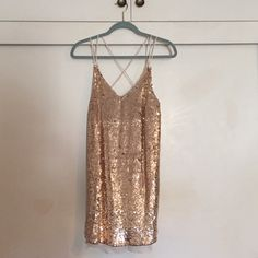 Free People Sparkler Mini Size small gold FP Sparkler Mini dress- last year's holiday style. Worn once but in great condition Free People Dresses Mini