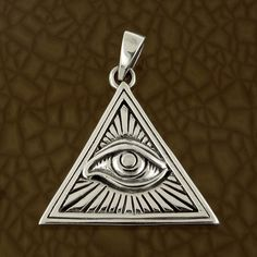 """All Seeing Eye Pendant in Solid 925 Sterling Silver - Illuminati Magic Charm. This pendant depicts the classic Illuminati magical symbol of power. It is made of solid sterling silver and is clearly stamped 925 on the back. It weighs 6.6g (0.23oz) including the bale. The pendant is 28mm (1.1"""") high, 30mm (1.18"""") wide and 1mm (0.04"""") deep. Buy Now - AU$38.29"""
