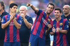 (L-R) Luis Suarez, Sergio Busquets and Lionel Messi of FC Barcelona look on during the official presentation of the FC Barcelona prior to the Joan Gamper Trophy match between FC Barcelona and Club Leon at Camp Nou on August 18, 2014 in Barcelona, Catalonia.