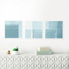 A set of 3 tranquil abstract prints with soothing blue tones that you can download instantly, giving you the flexibility to print at a variety of sizes up to 16 x 16 inches. Perfect for your beautiful home.