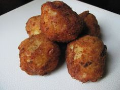 Yummy, comforting deep-fried rice balls filled with ham and onion, stuffed with melty, gooey cheese!  I came up with these tasty little morsels after having something similar at a tapas restaurant in my hometown.  Sadly, that restaurant closed its doors, so I was forced to recreate my favorite dish.  *I have made these with havarti and swiss cheeses instead of the cheddar: all are equally good!*  NOTE: After reading the review, please note: You definitely want to use rice that is somewhat…