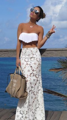 snowy peplum bralette, creamy floral lace waisted maxi skirt, beige Chanel handbag, tanned skin