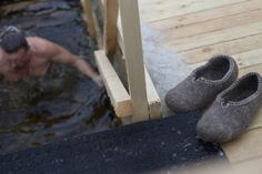 A Russian man eases himself into icy water while his slippers wait on a deck. Russian Men, Going Barefoot, Wooden Clogs, Object Lessons, Natural Vitamins, Your Shoes, Feel Better, The Outsiders, Slippers