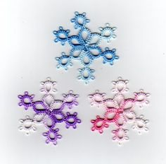 Snowflakes!  Join to make a necklace chain?