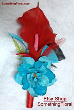 Red, mini calla lily and turquoise delphinium boutonniere with red satin stem…