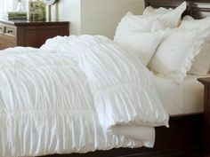Pottery Barn Hadley duvet. I can't decide on whether to get the white or cream...