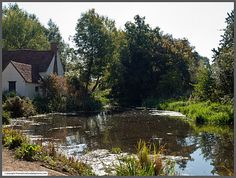 Flatford Mill Near Manningtree in Essex, UK.  Flatford Mill is a listed building made famous by the artist John Constable as in The Hay Wain.