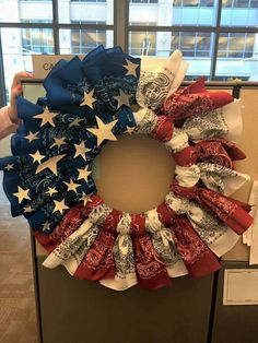 Cute bandana wreath. Buy white wreath, zip tie bandanas on and hot glue stars.