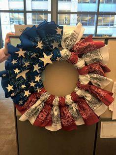 Cute bandana wreath. Buy white wreath, zip tie bandanas on and hot glue stars.