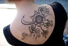 Women are just crazy about the designing of flowers. So they are never step back. See this beautiful Henna Mehndi Flower tattoo temporary design on full upper back of a women.