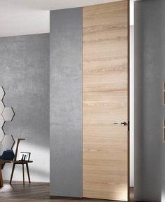 EXIT ZERO Finition : Rovere Natural touch Habillage : Invisible. Porte hauteur plafond. Marque Ferrero Legno. Disponible sur DirectPortes.fr, spécialiste de la porte intérieur italiennes.