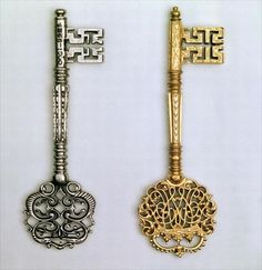 *Keys Left to Right: Ceremonial Chamberlain design incorporating Royal cypher, early 18th century gilt. Steel 18th century