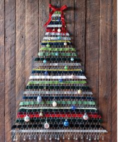 A DIY tree from Country Living: chicken wire, velvet ribbon, ornaments. More