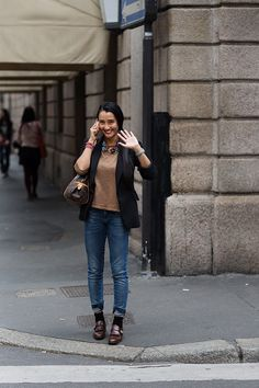 On the Street…..via Sant' Andrea, Milan - The Sartorialist Nice -- bright pop of color in the necklace against a completely neutral background.