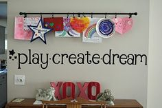 "Use a curtain rod and curtain ring clips to display children's art work. Stencil the word, ""Masterpieces"" or ""Treasures"" on wall above rod, to account for all sizes of work."