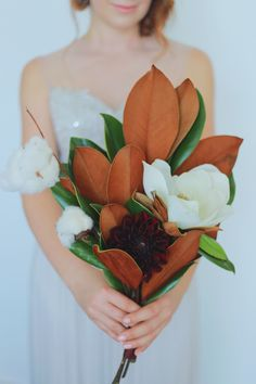 magnolia bouquet, photo by Tina Chiou Photography http://ruffledblog.com/wedding-inspiration-with-magnolia-leaves-and-cotton #weddingbouquet #flowers #bouquets