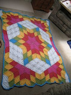 Free Prairie Star Afghan Pattern via Ravelry Prairie Star afghan in bright cheerful colors All based on same triangle motif block (plus a few squares for setting the corners) in different colors  arranged just as you would for the quilt block this is inspired by. Could be a very versatile technique adapted to many quilt block patterns. (NCS)