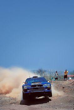 Rally drive. Subaru kicking up dust.