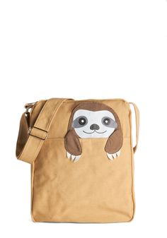 OMG!!! Got One Friend in My Pocket Bag in Sloth. Keep your favorite critter pal nearby with this canvas messenger bag. #tan #modcloth