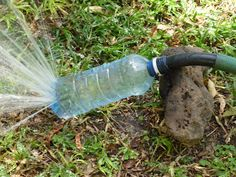 Hose and a water bottle diy sprinkler. This would be good for when we put the turf down.