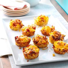 Scrambled Egg Hash Brown Cups Recipe -They may look like muffins, but these cuties pack my favorite breakfast all-stars like eggs, hash browns and bacon. Grab one and get munching. —Talon DiMare, Bullhead City, Arizona