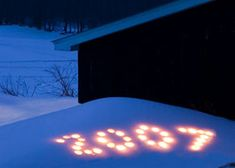 Even though this particular picture shows an old date this is a great idea. Just put candles in coffee cans or other containers in the snow (if you have it) to spell out 2013! LOVE IT!