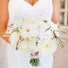 softly shaded bunch of white peonies, veronica, orchids and berries.
