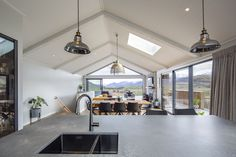 This open plan layout is made to feel even more spacious by the use of a cathedral ceiling and an extensive wrap around deck. Wrap Around Deck, Drinks Cabinet, Ceiling Beams, Open Plan, Man Cave, Cathedral, Design Inspiration, Layout, How To Plan