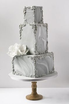 Marble and bas-relief wedding cake by Wildflower Cakes London www.wildflowercakes.co.uk