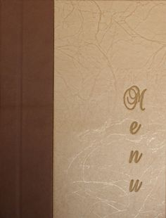 Custom menu folder with pyrographic material and embossing.