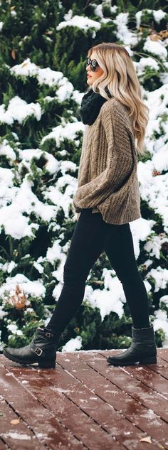 The equation for a perfect winter ensemble: Dark denim/leggings, chunky sweaters, a scarf and pair of moto boots! Stay warm with chunky knits and rugged boots this winter, you'll look ultra chic no matter where you're heading! Where would you sport this look?