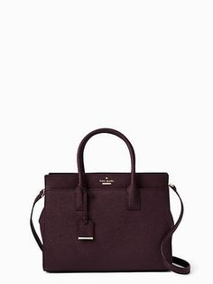 the cameron street candace combines a classic shape with a number of clever details, including exterior slide pockets, a dropped zip-top closure, an optional (and adjustable) shoulder strap and a matc