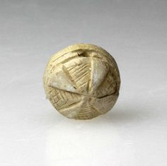 An Egyptian Incised Button Scarab for Neith, XII Dynasty, ca 1992-18020 BC