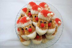 Nutter Butter Santa's thanks to Colleen! What you need: 1 package of Nutter Butter Cookies 1 pound of white chocolate candies Red sugar Red hots candies or other small red candies Mini chocol…