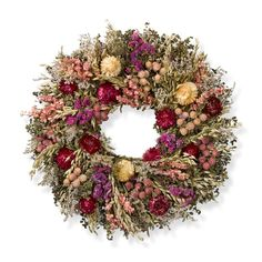 Pink Prairie Wreath - Larkspur, statice, globe amaranth and strawflowers brighten the arrangement with rich hues that vary from pale pink, rose and cream to deep violet. Aromatic marjoram and savory, interspersed with avena oats, create the perfect backdrop.